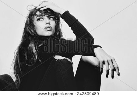 Sensual Woman Body. One Attractive Stylish Sensual Young Woman In Black Sweater And Torn Slim Jeans