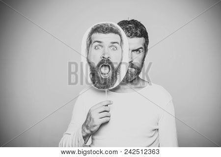 Serious Man. Barber Fashion And Beauty. Hipster With Surprised And Serious Face Hold Portrait Namepl