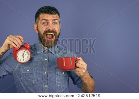 Mens Heals Body Care. Man Drink Morning Coffee Or Tea With Alarm Clock. Refreshment Break And Energy