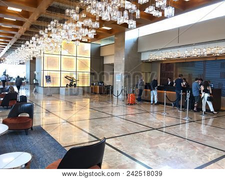 Tel Aviv, Israel - May 15, 2018: Guests At The Hilton Hotel Lobby Desk. Situated In Independence Par