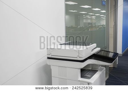 Standing Multifunction Printer In Office For Printing, Copying, Scanning Documents