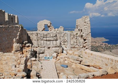 HALKI, GREECE - JUNE 6, 2015: The ruins of the medieval Crusader Knights castle on the Greek island of Halki. The castle is a popular tourist destination on the small Dodecanese island.