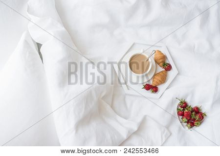 Early Morning Breakfast In Bed, Coffee And Croissant With Strawberries On The Tray In Fresh White Be