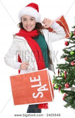 Woman Shopping At Christmas
