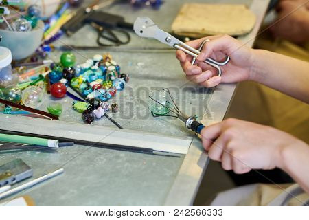 Close Up Of Unrecognizable Female Artist Shaping Glass While Making Beads For Beautiful Handmade Jew