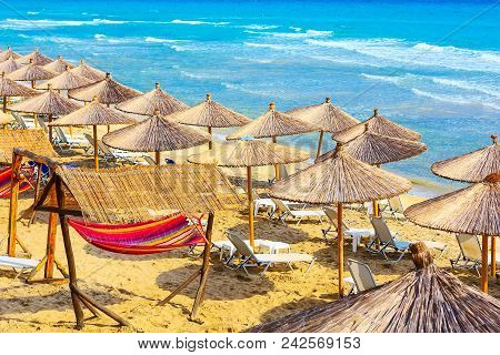 Summer Greek Beach Vacation Panoramic Background With Turquoise Sea Water Waves And Umbrellas, Greec