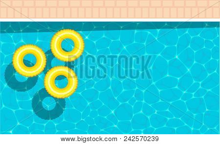 Beautiful Background On The Sea Topic With Yellow Pool Float. Ring Floating In A Refreshing Blue Swi