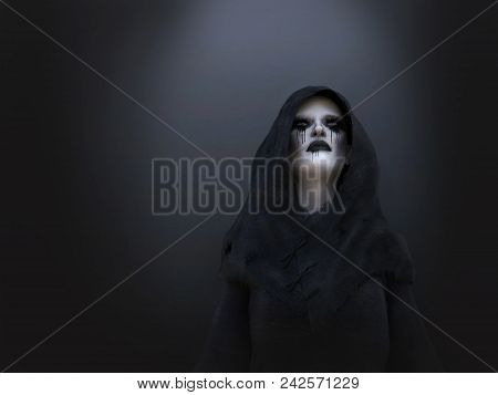 3d Rendering Of A Female Death Angel Or Demon Wearing A Black Hood. Dark Background.
