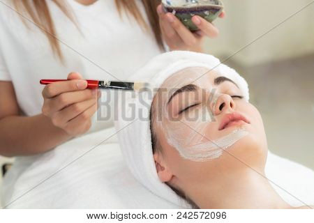 Beautiful Woman Having A Facial Treatment At Spa.