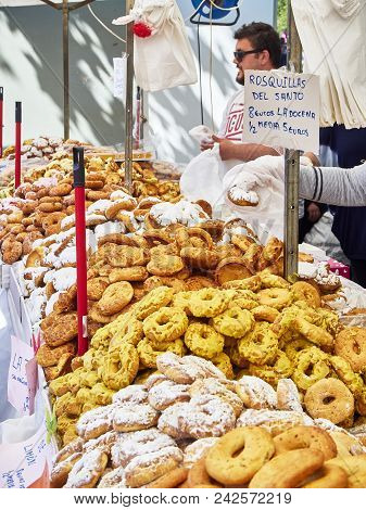 Madrid, Spain - May 15, 2018. Bakers Selling Rosquillas Del Santo, Typical Spanish Sweet, In A Baker