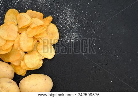 Chips Preparing. Crunchy Food Crisps Cooking. Salty Ridged Fried Slices And Fresh Organic Potatoes O