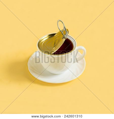 Cup Of Coffee Like Open Tincan On Yellow Background. Minimal Style. Creative Idea, Imagination And F