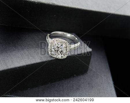 Close Up Of An Engagement Diamond Ring On Black Box Background. Soft And Selective Focus. Love And W