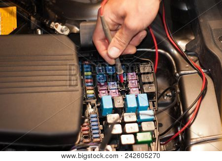 Technicain Checking Car Fuse By Lamp Tester Which Nagative Pole Of Lamp Tester Connected With Car Fr