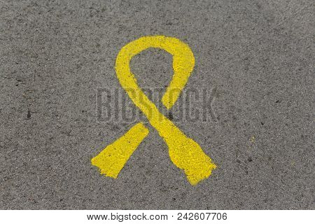 Yellow Tie Painted On The Asphalt. Symbol Of