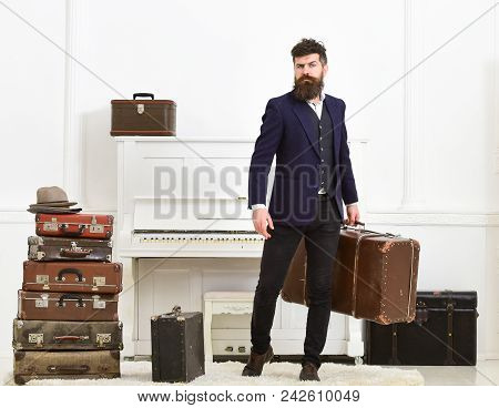 Luggage And Vacation Concept. Man, Traveller With Beard And Mustache With Luggage, Luxury White Inte