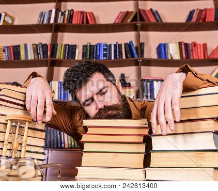 Teacher Or Student With Beard Fall Asleep On Books, Defocused. Overstudied Concept. Man On Sleeping