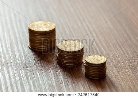 Kopeks The Ukrainian Currency, Coins On A Wooden Table.