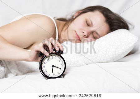 Girl Is Sleeping In Bed And Turns Off Alarm Bell In Early Morning