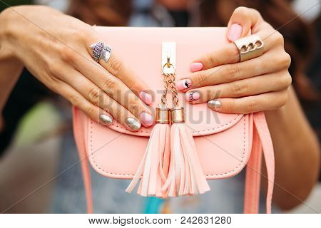 Close-up Of Unrecognizable Woman With Fashionable Manicure Of Golden And Pink Colors With Picture We