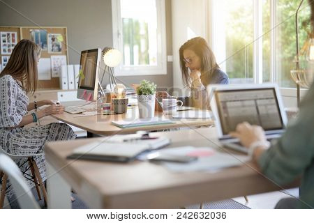 Businesswomen working in co-working space