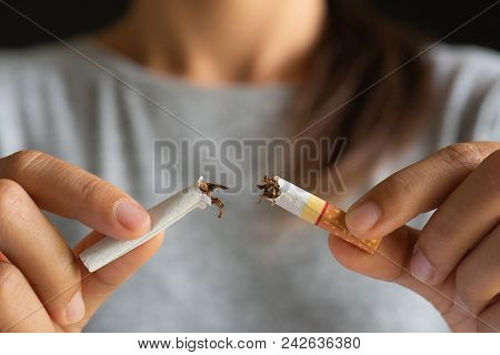 World No Tobacco Day, May 31. Stop Smoking. Close Up Woman Hand Breaking, Crushing Or Destroying Cig