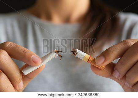 World No Tobacco Day, May 31. Stop Smoking. Close Up Woman Hand Breaking, Crushing Or Destroying Cig