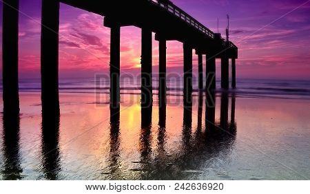 Shadows Of A Saint: Saint Johns Fishing Pier At Sunrise, Saint Augustine, Florida