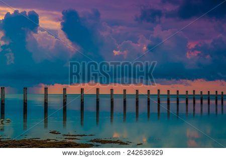 Taking A Stand: Wooden Pillars In The Atlantic Ocean At Sunrise, Islamorada, Florida