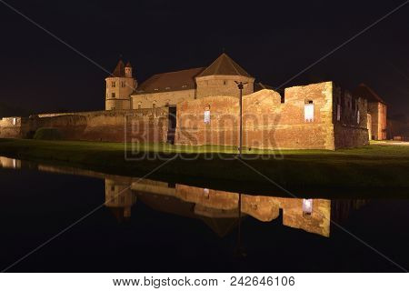 Fagaras Medieval Fortified Fortress In Transylvania, Romania. At Night
