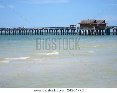 Wood Pier By Beach In Naples Florida