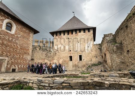 Khotyn, Ukraine - May 19, 2018: The Yard Inside Of Khotyn Fortress On A Cloudy Day. There Is A Group