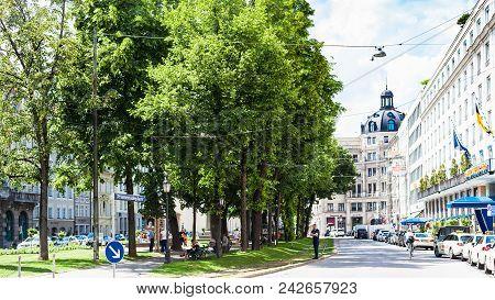 Munich, Germany - May 23, 2018: People On Green Square At Promenadeplatz In Munich City. Munich Is T