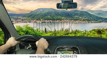 Driving A Car Towards The Town Of Salo, On The Lake Garda, Italy