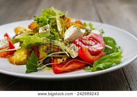Appetizing Vegetable Salad With Letuce And Croutons. Mediterranean Cuisine, Banquet, Restaurant Menu