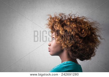 Profile of girl with curly hair