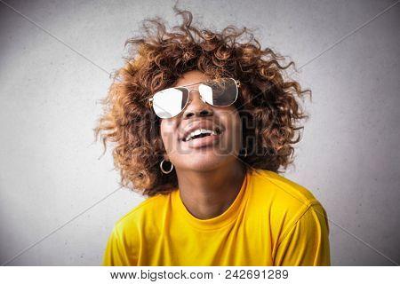 Pretty woman wearing stylish sunglasses