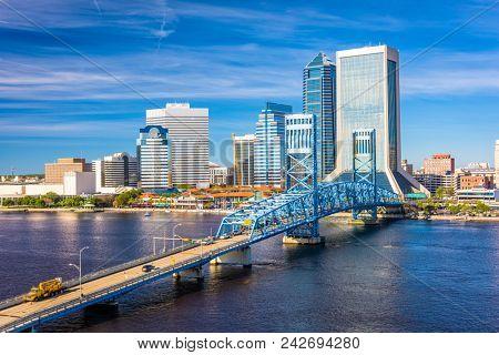 Jacksonville, Florida, USA downtown skyline at dusk over St. Johns River.