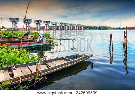 Local Fishing Boat Of Thailand With Uthokwipat Prasit Watergate Background For Prevent Sea Water Fro
