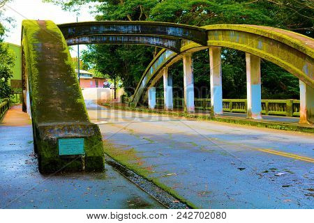 Bridge Covered With Moss Over The Wailuku River Surrounded By A Tropical Rain Forest Taken In Hilo,
