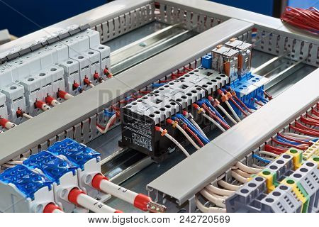Contactors, Relays, Circuit Breakers And Terminals In The Electrical Cabinet. Electrical Wires Or Ca