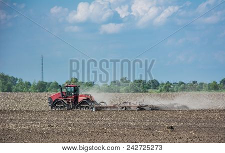 Tractor Working On The Field, A Modern Agricultural Transport, Fertile Land, Cultivation Of Land, Ag