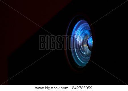 Photo Depicts Digital Projector Film Presentation. Projector Shiny Colorful Glass Lens Closeup, Macr