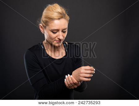Gym Female Trainer Holding Wrist Like Hurting.
