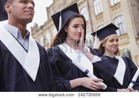 Feeling Touchy. Dark-haired Beautiful Student Feeling Very Touchy While Standing Near University On