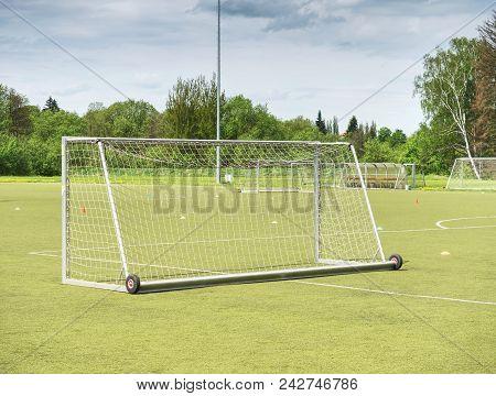 On Football Soccer Field. Behind Goal Of Soccer Field. Soccer Football Net Background Over Green Gra