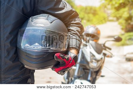 Man In A Motorcycle With Helmet And Gloves Is An Important Protective Clothing For Motorcycling Thro