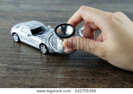 Stethoscope Checking Up The Car, Concept Of Car Check-up, Repair And Maintenance..