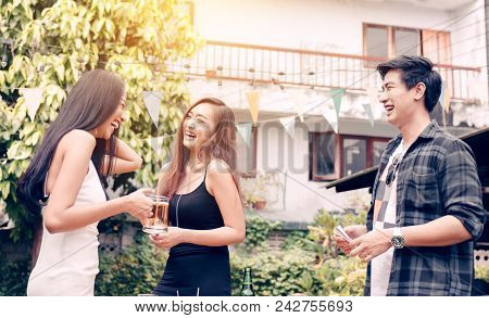 Happy Asian Teen Celebrate About Education Congratulate Together At Garden In Home.