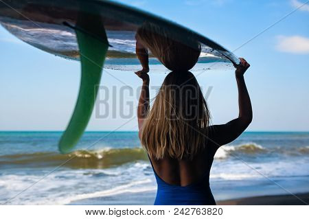 Girl In Bikini With Surfboard Walk On Black Sand Beach. Surfer Woman Look At Sea Surf And Water Pool